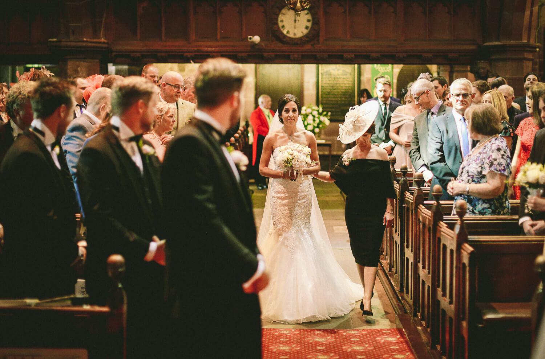Bride walking down the aisle All saints church Liverpool
