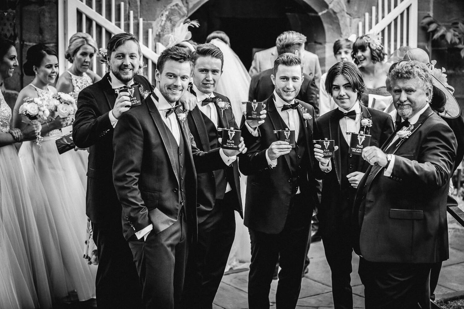 Ushers with wedding hip flasks