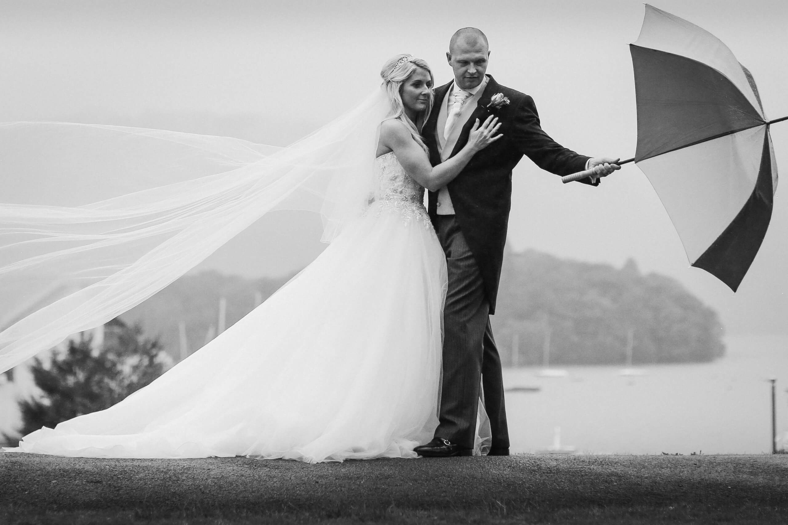 The Belsfield Hotel Wedding photography, Bride and groom with umbrella in rain