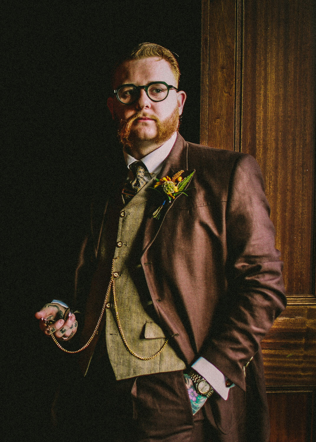 Portrait of vintage groom in window with pocket watch