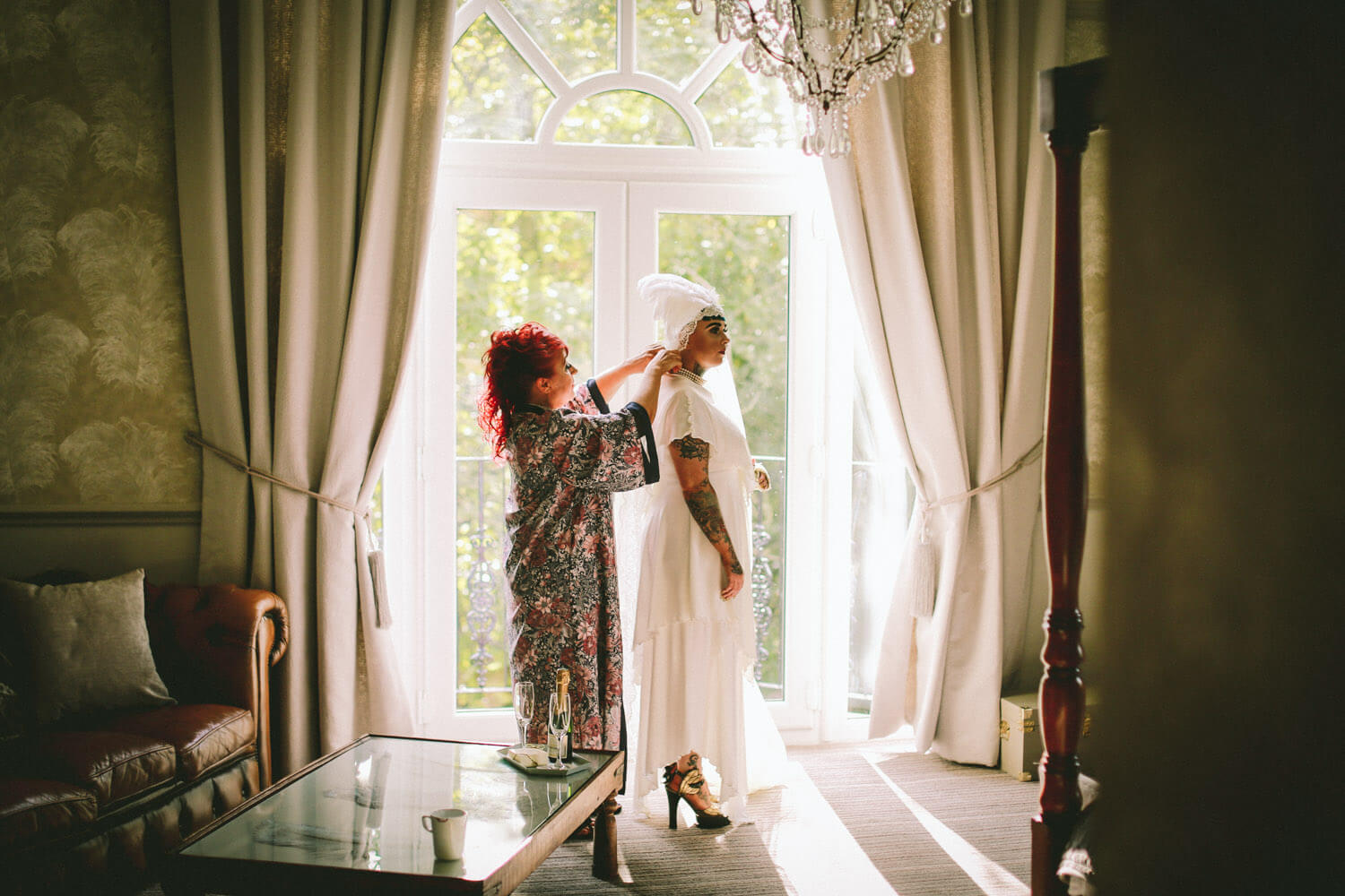 Mother of bride and daughter getting ready in window