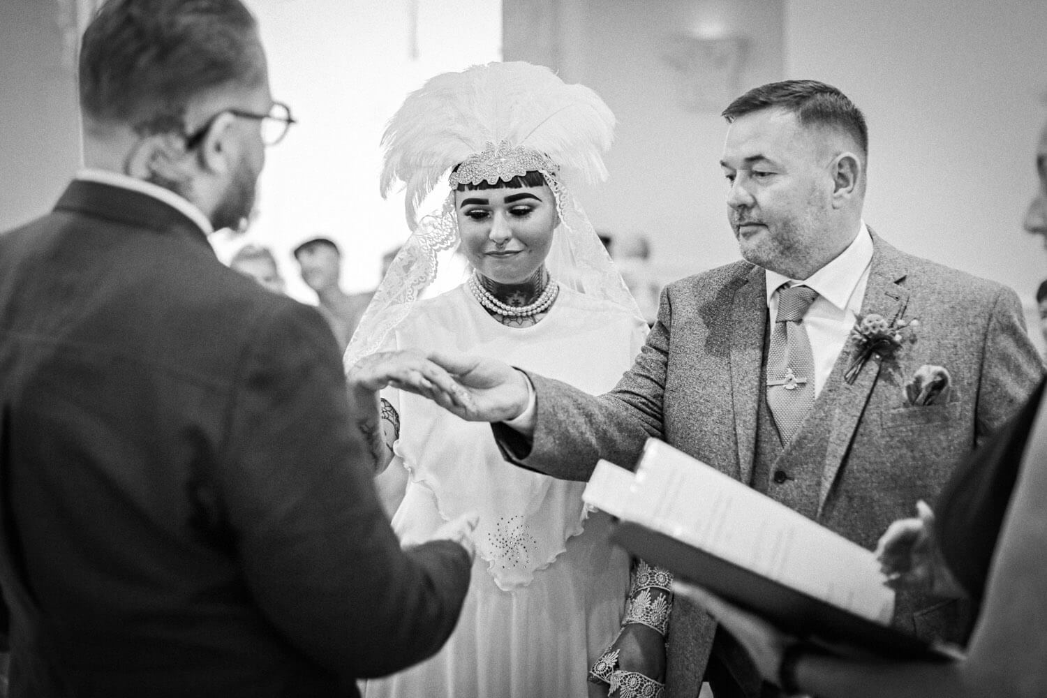 Father of vintage bride giving her away