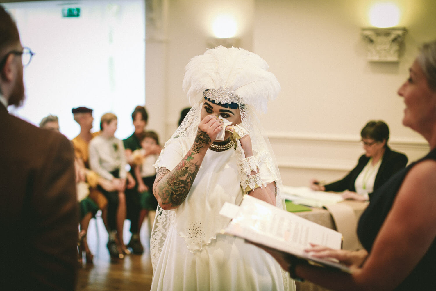 Vintage bride crying during ceremony