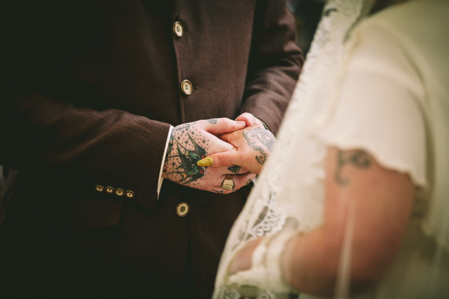close up of tattoo hands at wedding