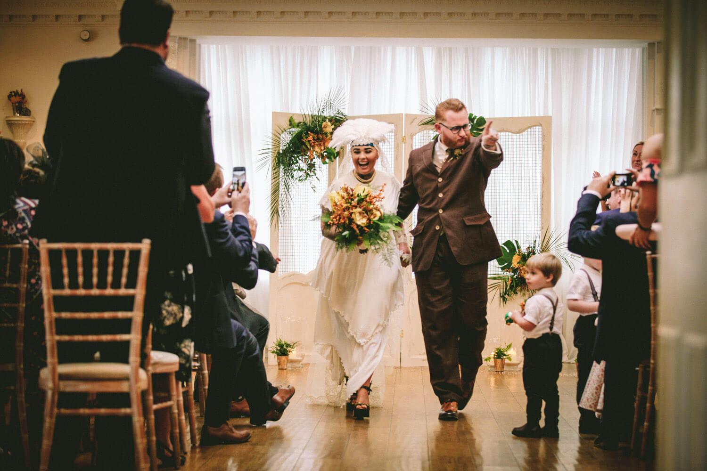 Vintage wedding bride and groom walking down aisle ashfield house wedding venue