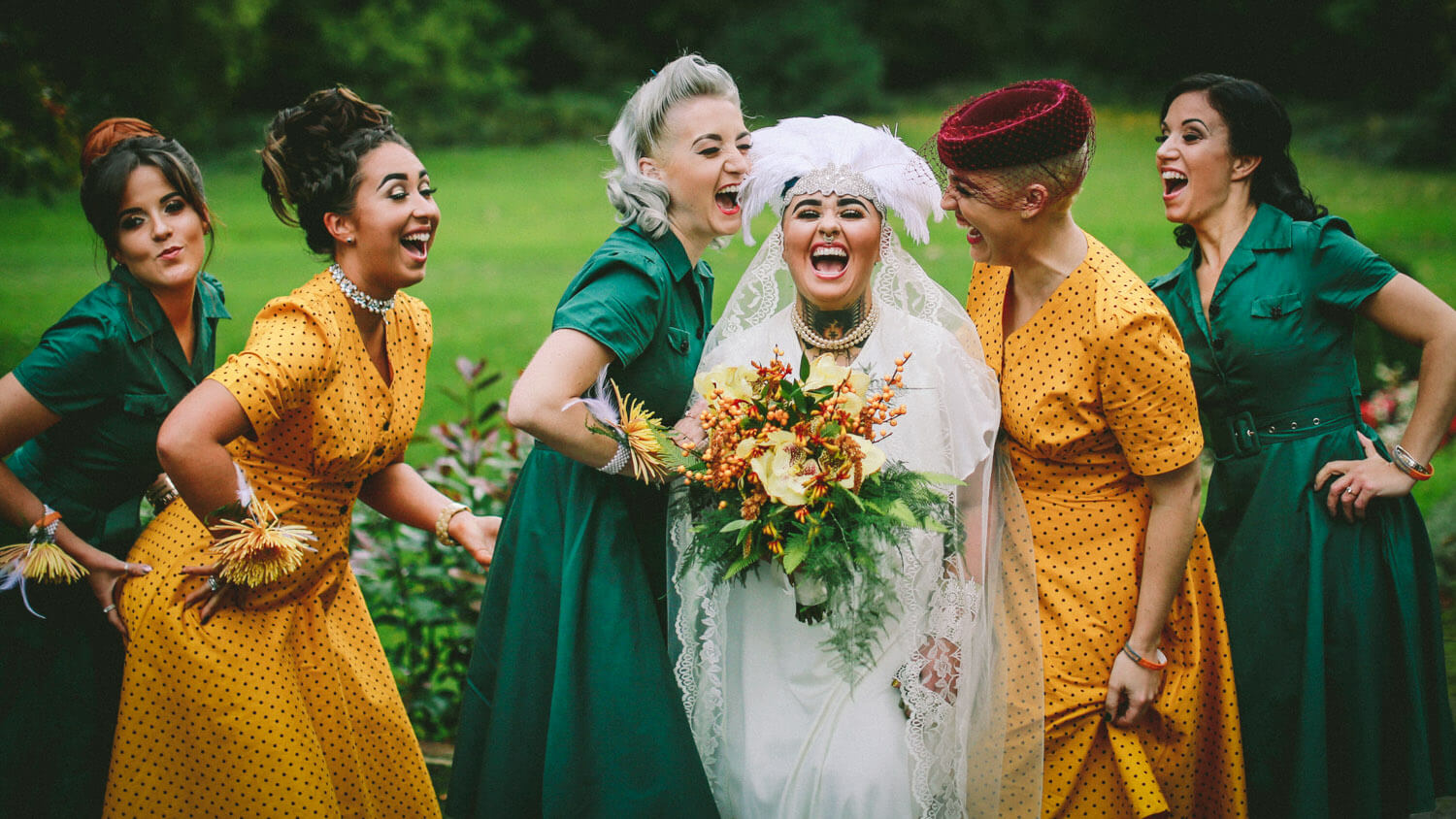 Ashfield House vintage wedding photography, Bride and bridesmaid laughing wearing yellow and green dresses