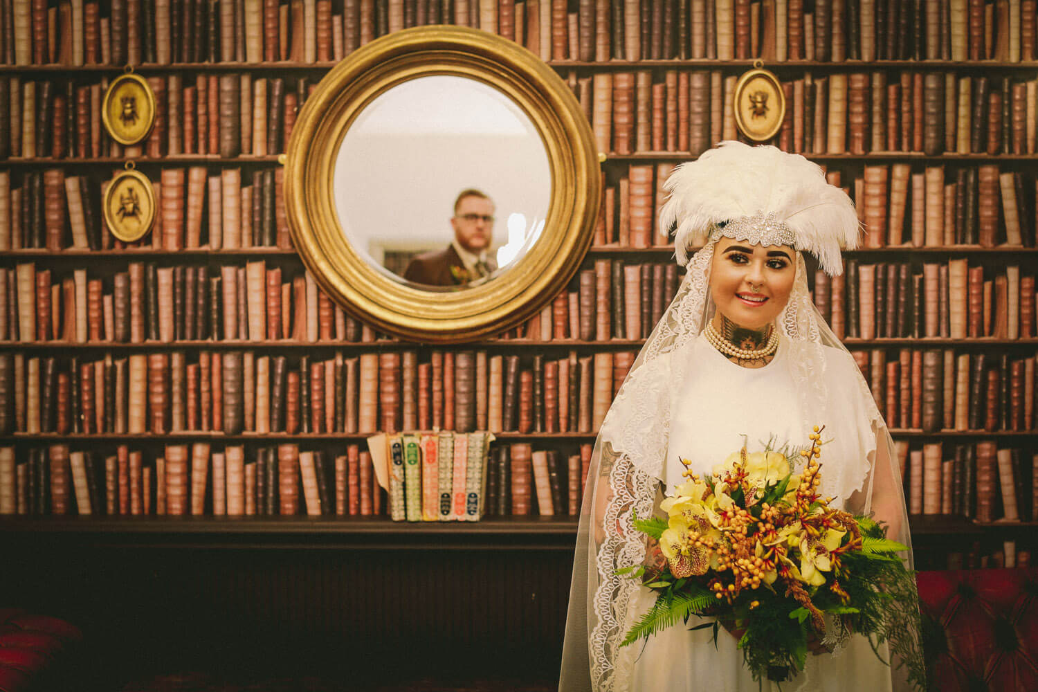 Vintage bride wearing headwear and reflection of groom in mirror