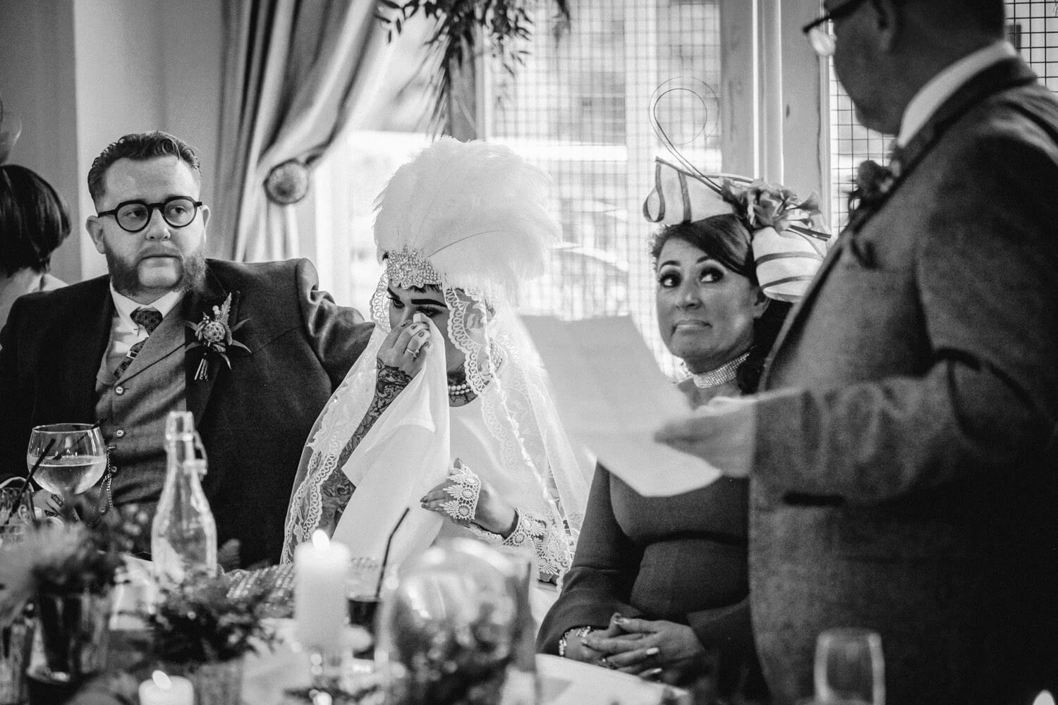 Emotional vintage wedding speeches, bride crying wearing headwear