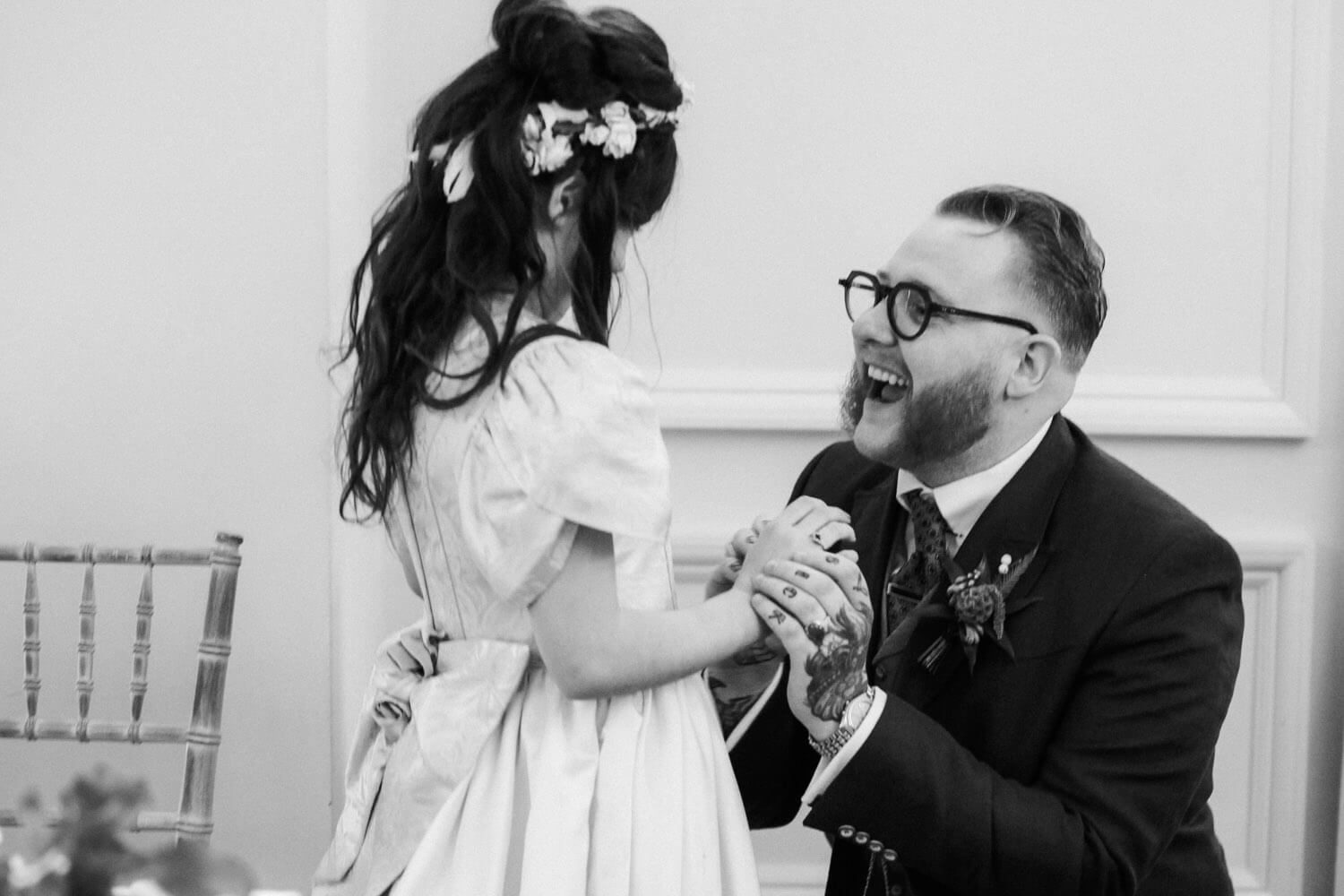 Father giving daughter a ring during wedding speeches