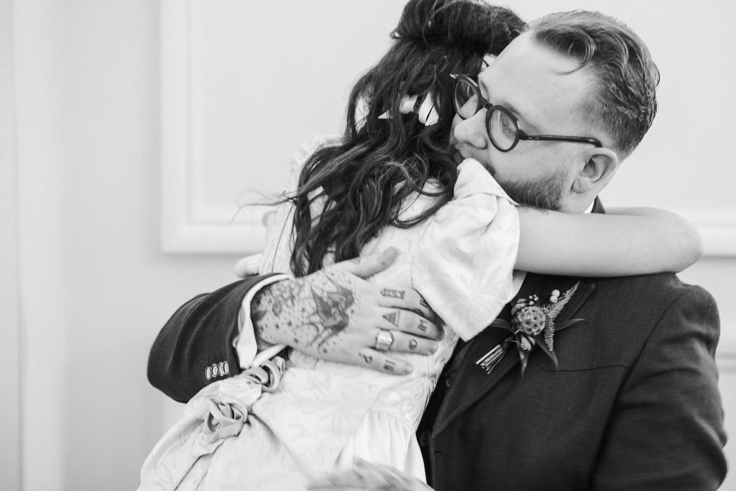 father and daughter hugging during wedding speeches