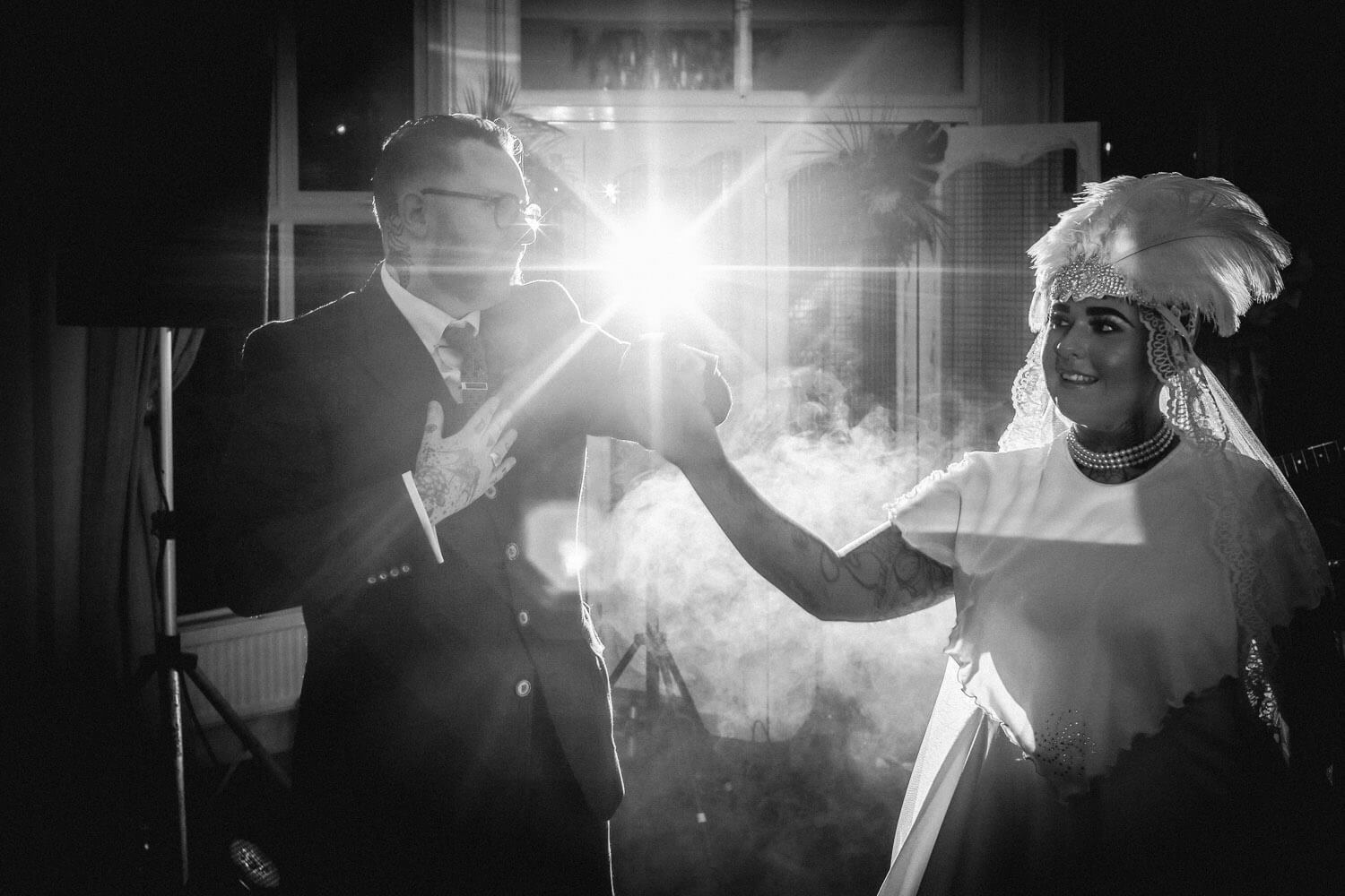 Vintage wedding first dance in black and white with smoke