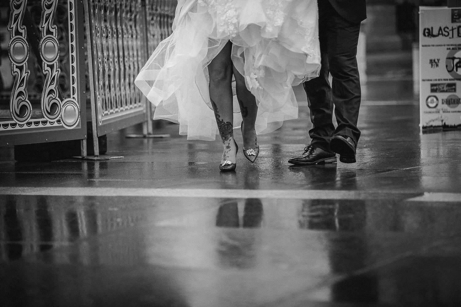 Bride with tattoo legs showing Jimmy Choo shoes with Ronald Joyce wedding dress