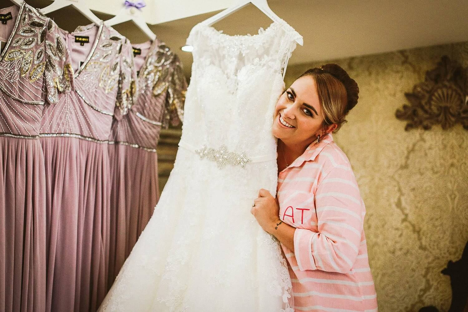 Happy bride hugging her Ronald Joyce wedding gown