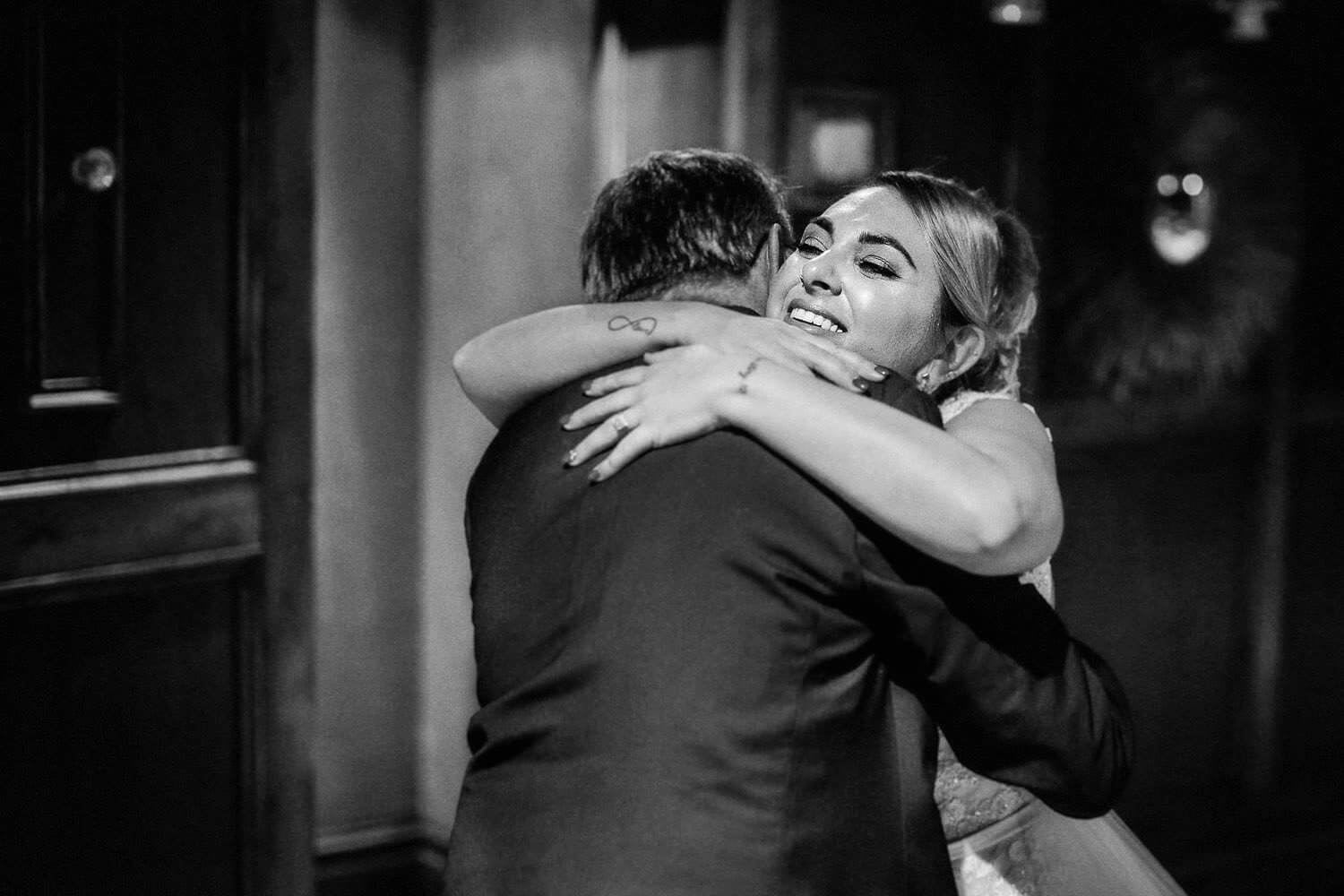 Daughter hugging dad on wedding day reveal Royal Liver Building wedding photography