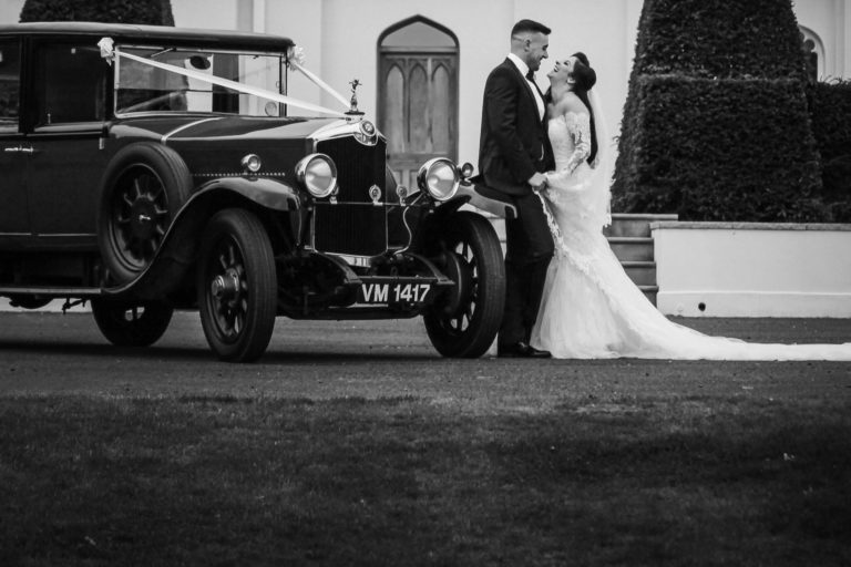 combermere abbey wedding photography bride and groom with classic car at abbey