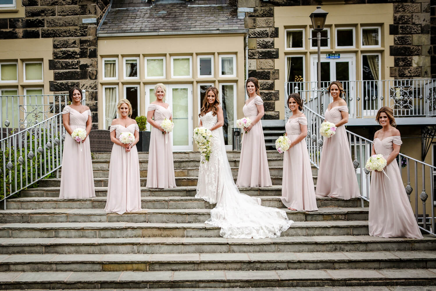 Bridal party photo bride and bridesmaids on steps