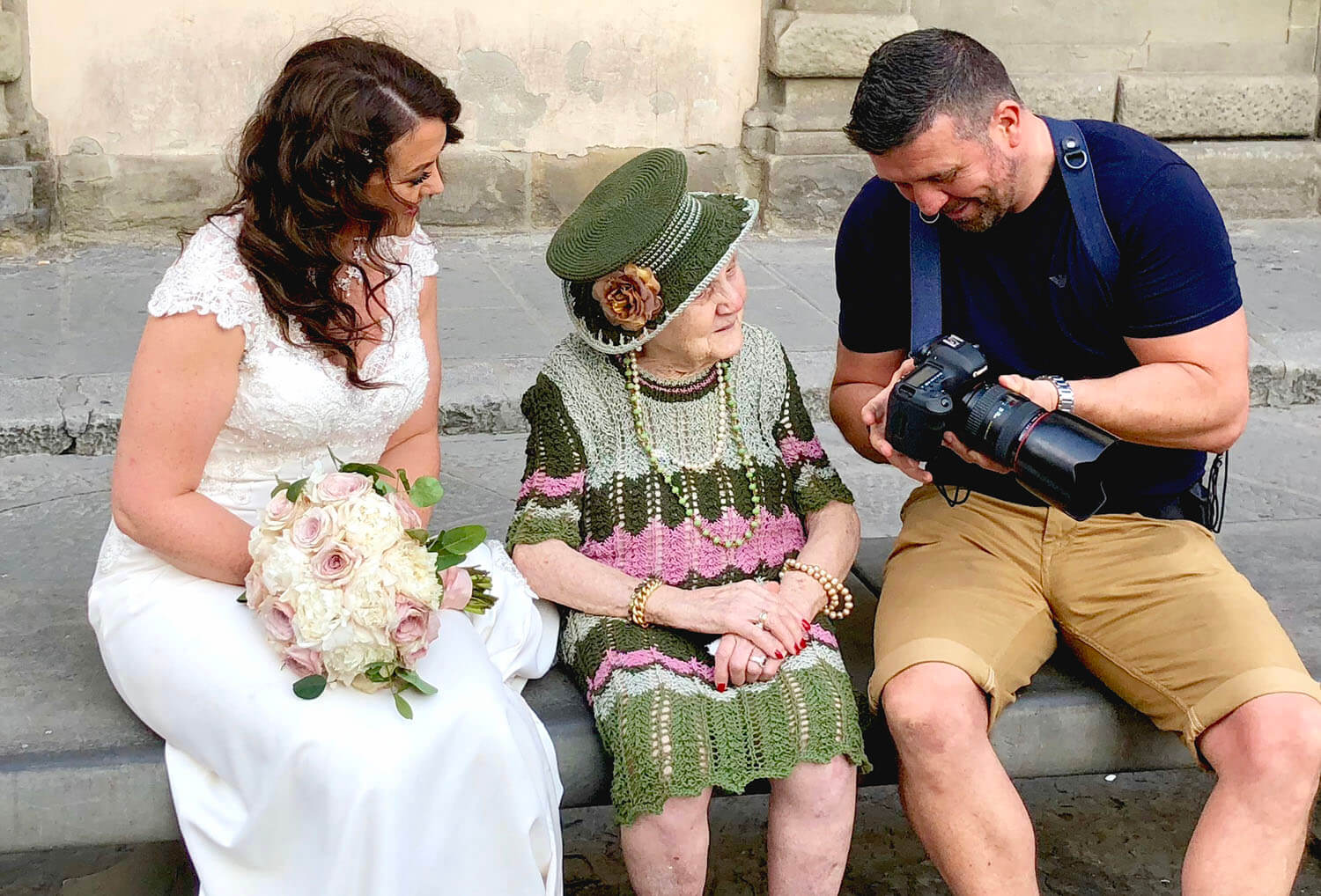 wedding photographer of the year 2019 Wes Simpson showing bride and little old lady the back of his camera