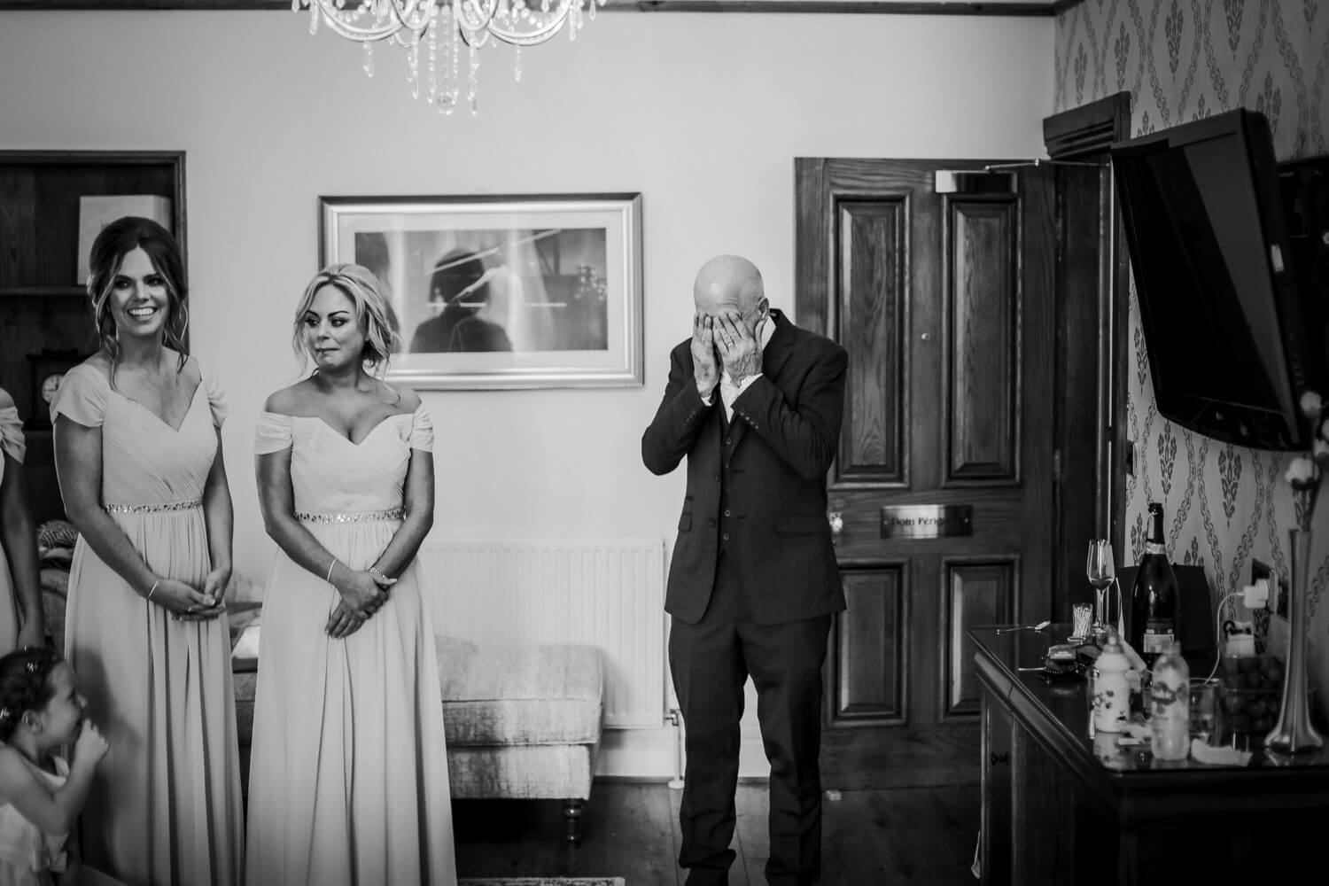 Emotional father of the bride coving face with hands