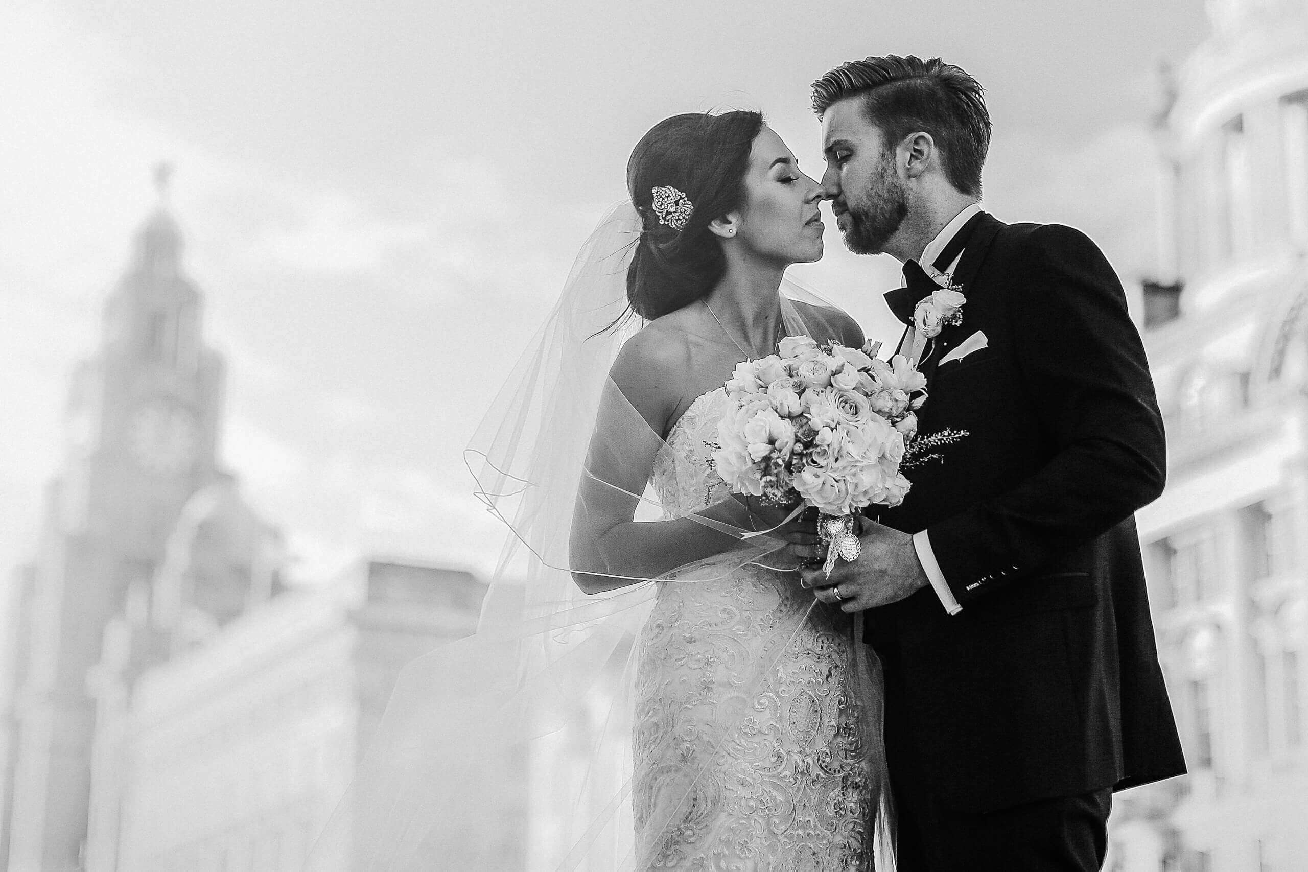 Black and white photo of bride and groom almost kissing in Liverpool by West Lancs wedding photographer