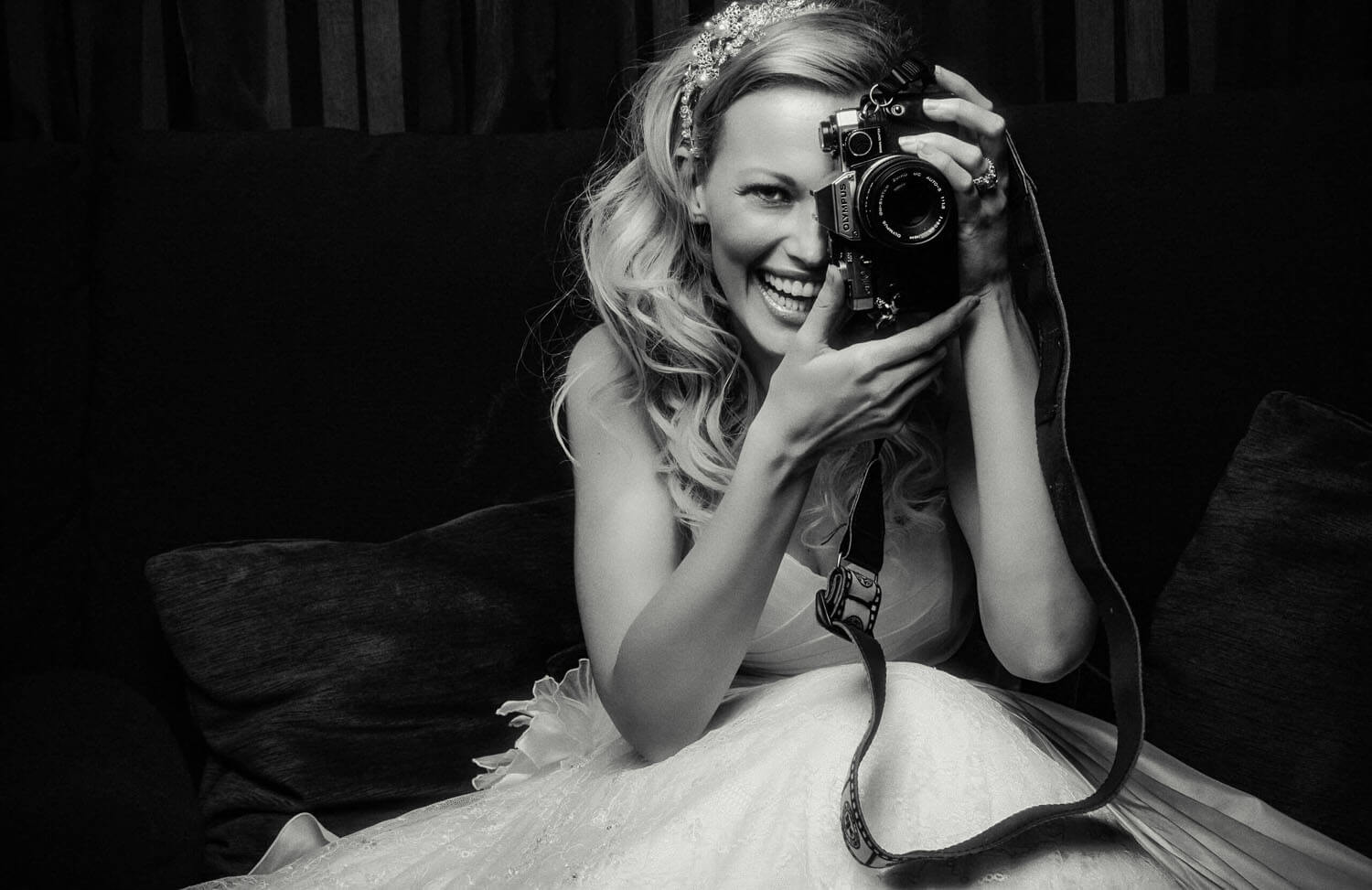 Photo of beautiful model bride with old-fashioned camera