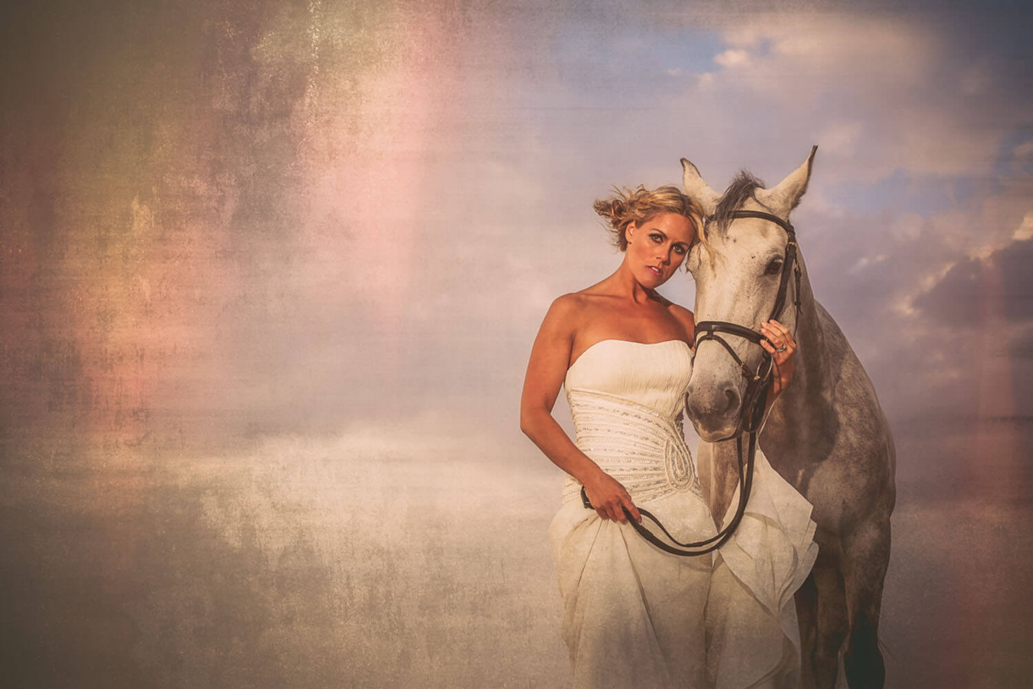 Portrait of model bride with white horse