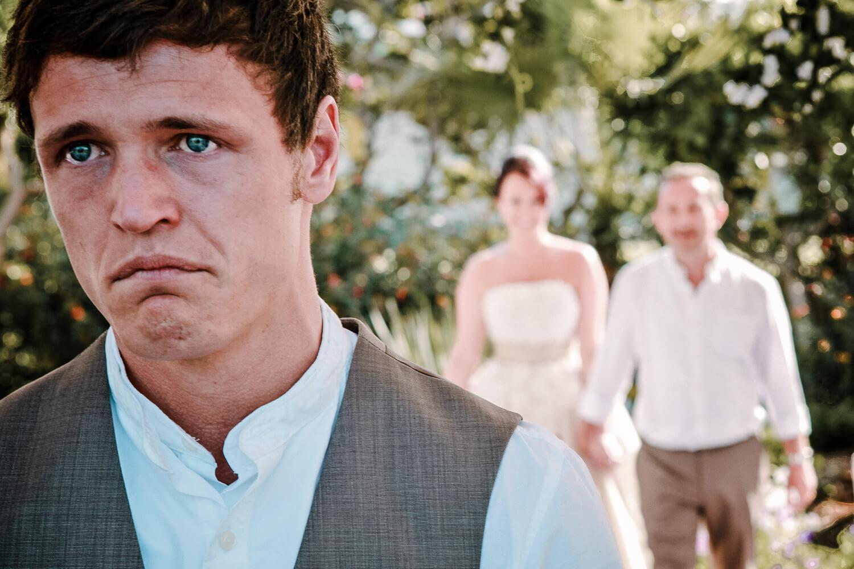 Groom crying as bride walks down aisle, how many wedding photographers do I need?
