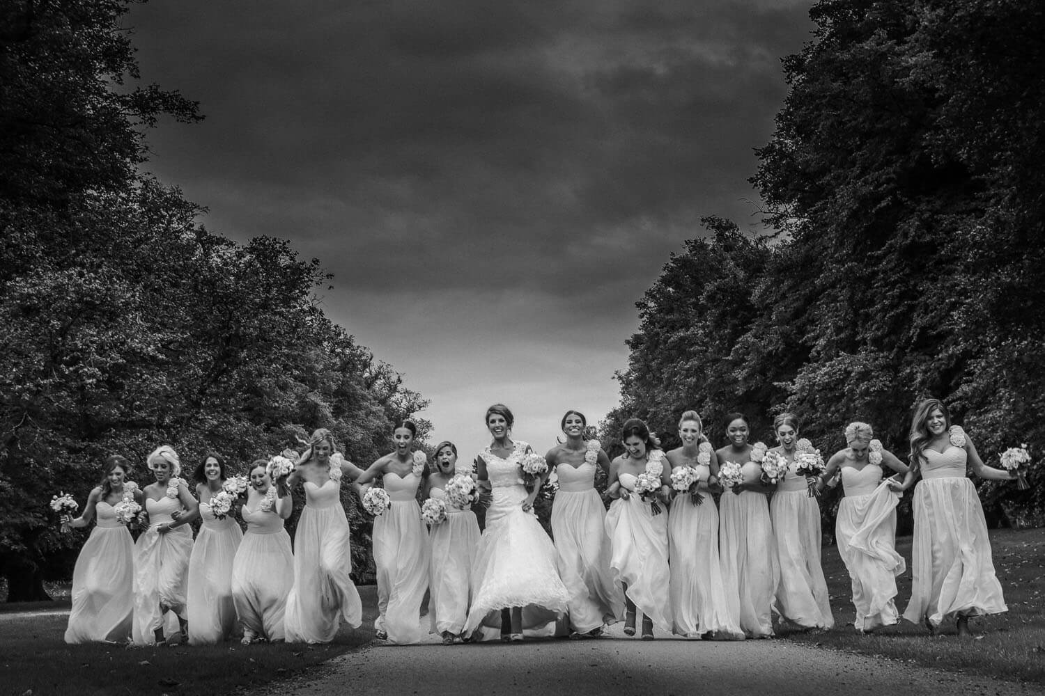 do I need second wedding photographer. Pic of bride and 10 bridesmaids running at camera