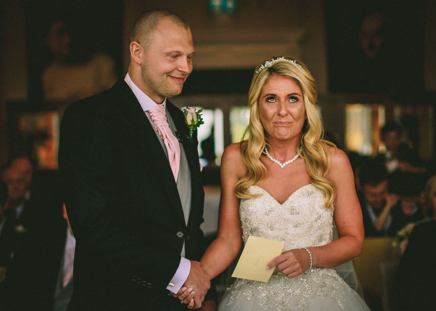 Do I need 2nd wedding photographer example. Bride fighting back tears during wedding ceremony