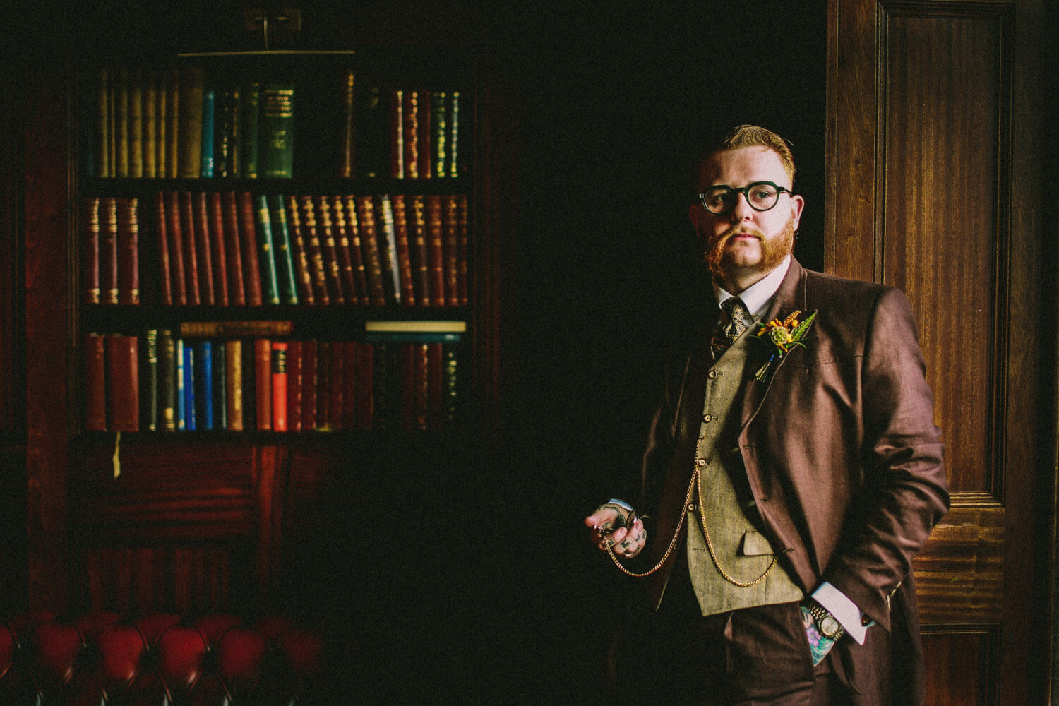 Portrait of vintage looking groom with glasses and pocket watch