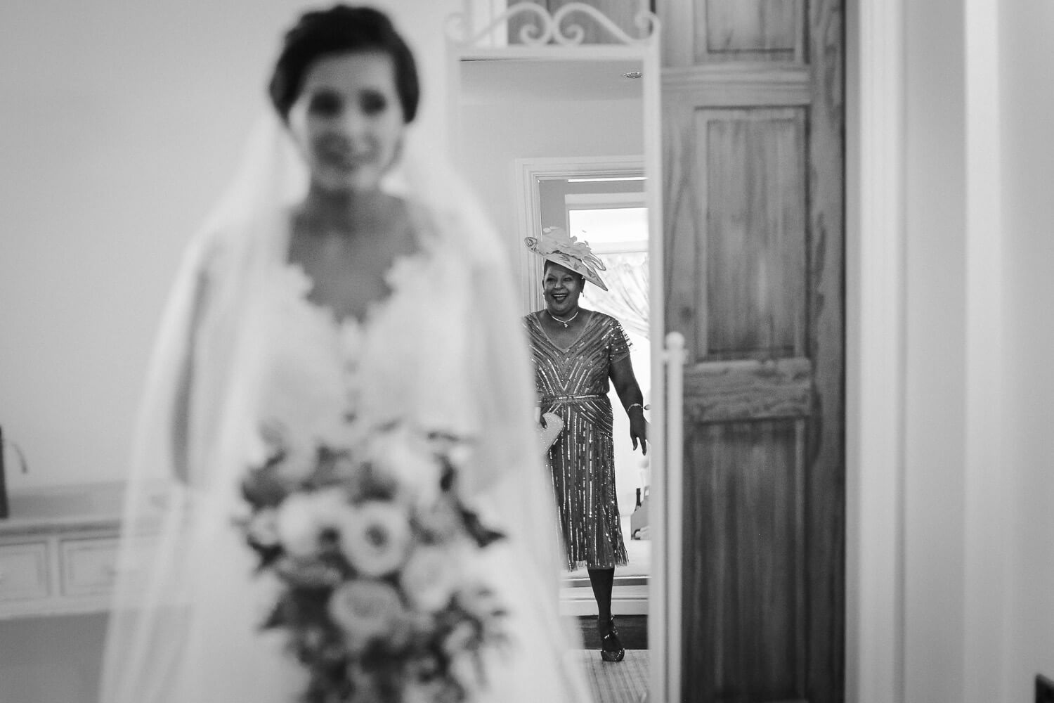 Bridal Reveal with reflection of mother of bride in mirror Sandhole Oak Barn wedding photography