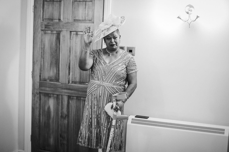 Emotional mother of bride during bridal reveal at Sandhole Oak Barn