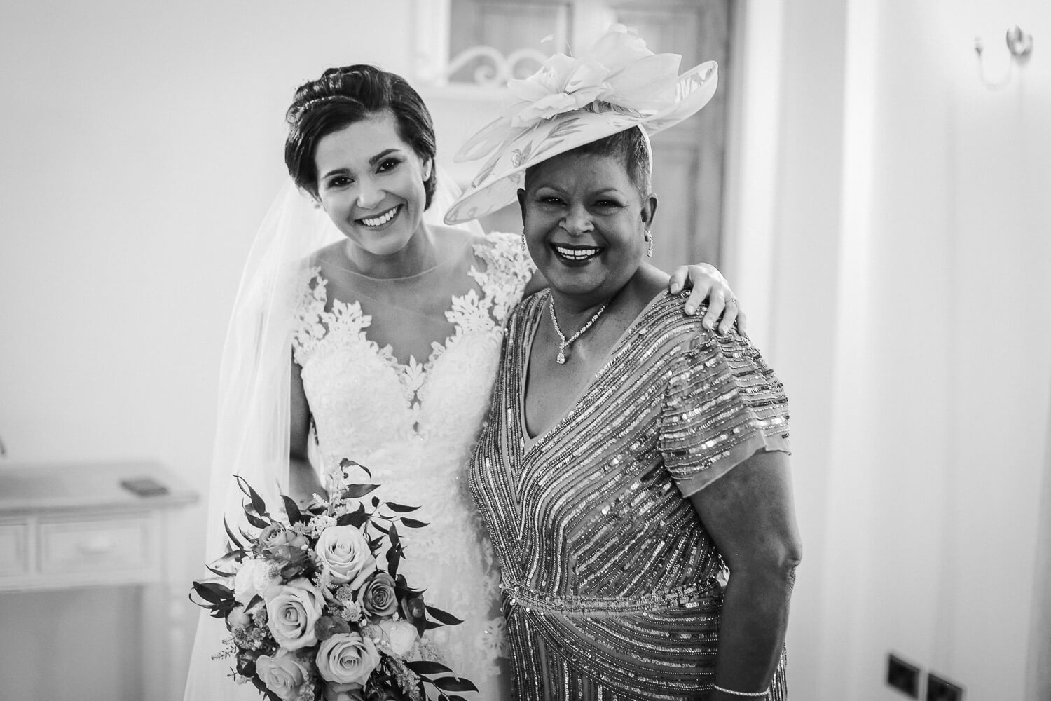 Mother of the bride and bride on wedding morning