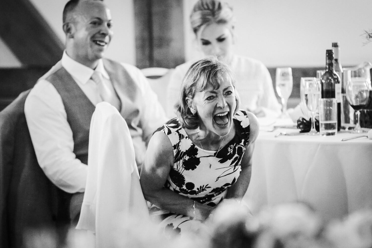 Woman laughing during speeches at sandhole Oak Barn