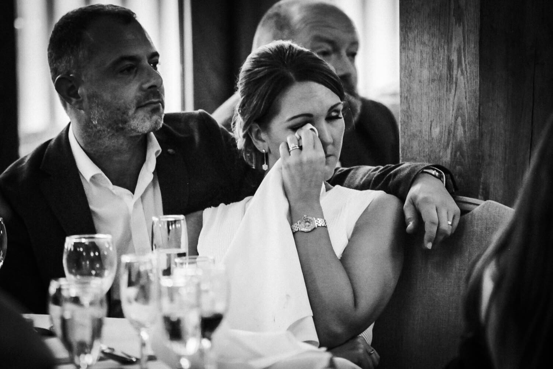 Woman drying tears during speeches at Sandhole Oak Barn wedding