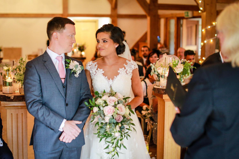 Bride and groom during wedding ceremony Sandhole Oak Barn