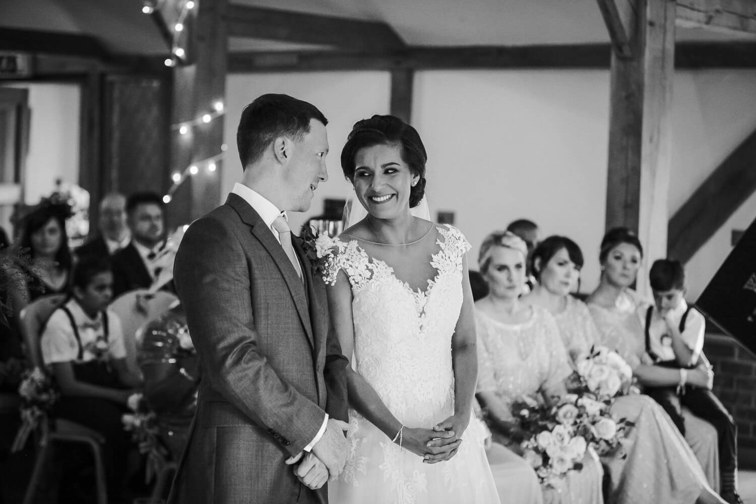 Black and white photo of bride and groom during ceremony Sandhole Oak Barn
