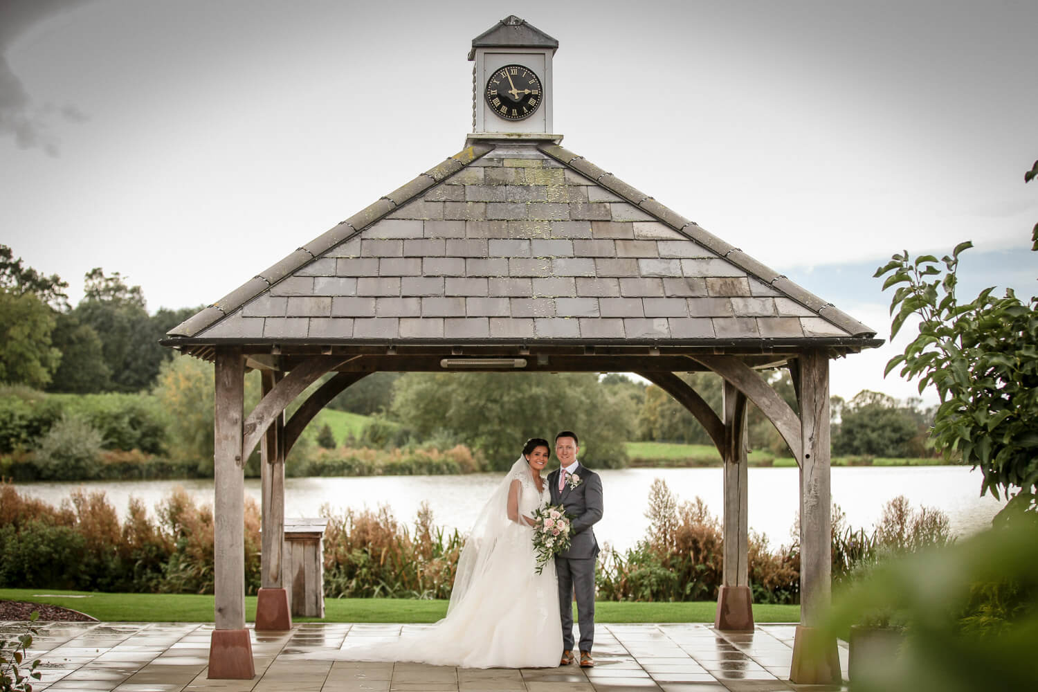 Bride and groom under clock tower Black and white photo bride and groom walking down the aisleBride walking down the aisle Sandhole Oak Barn