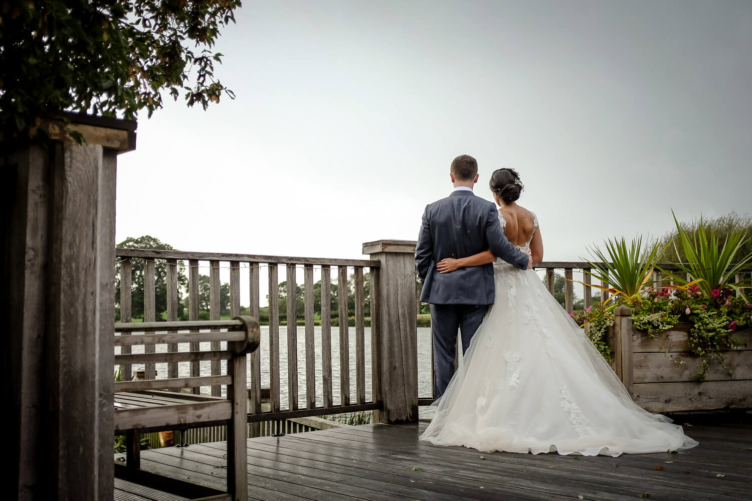 Sandhole Oak Barn wedding photography. Bride and groom looking at lake