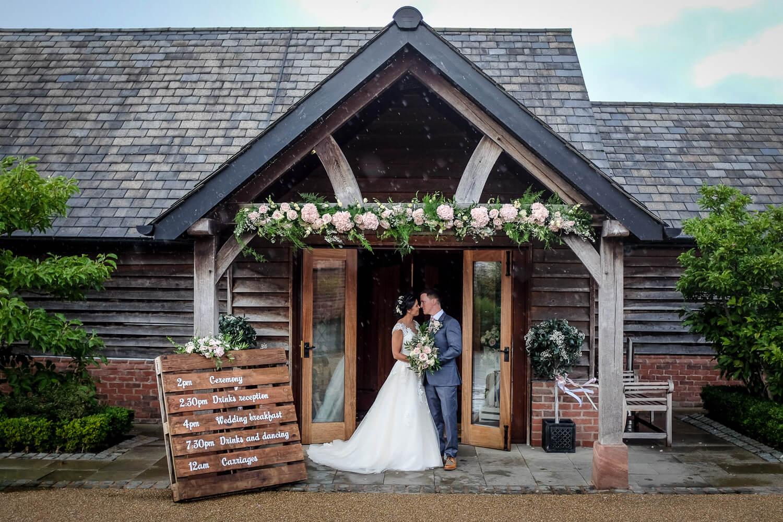 Bride and groom in door way Sandhole Oak Barn wedding photography