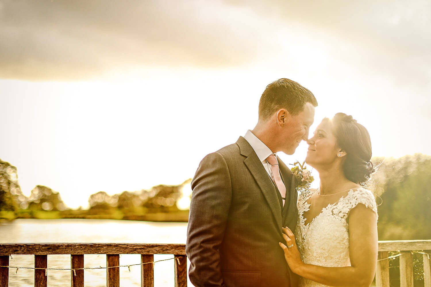 Sunset photo of bride and groom with lake in background Sandhole Oak Barn wedding photography
