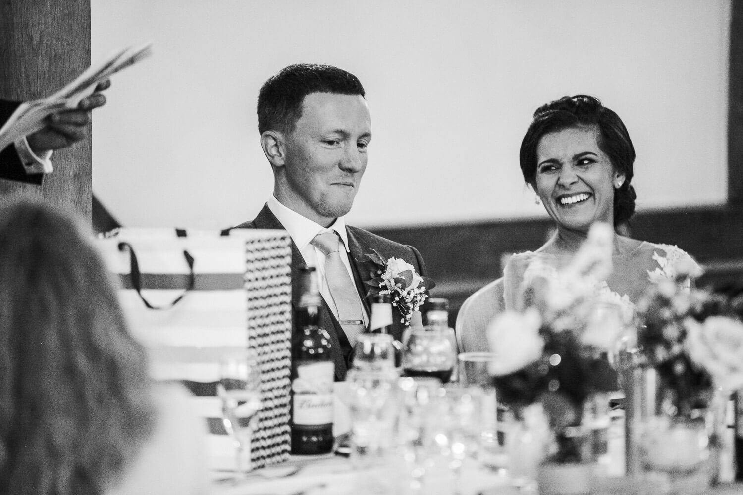 Bride laughing at groom during speeches