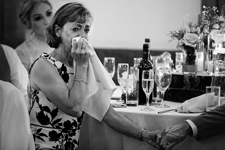 Emotional guests during wedding speech Sandhole Oak Barn wedding photographer