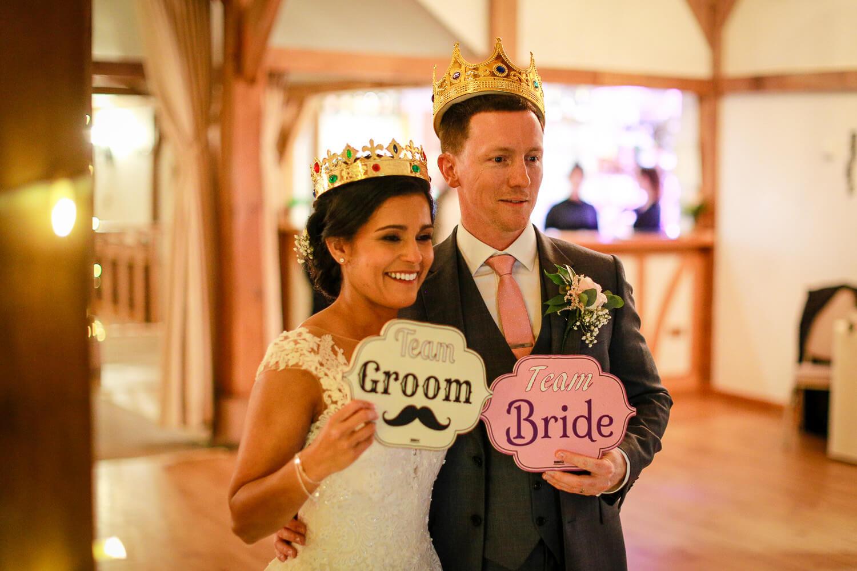 Bride and groom wearing crowns