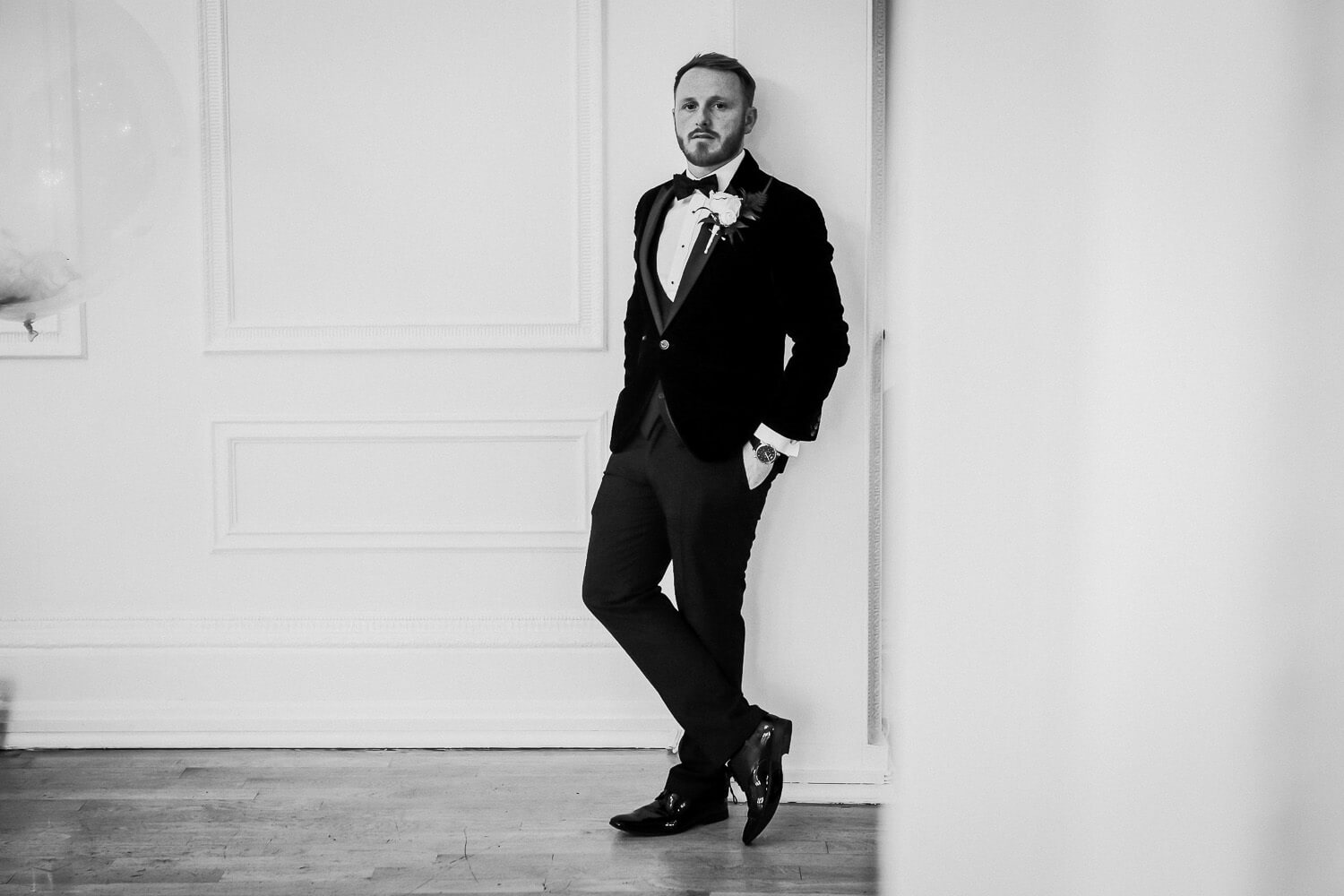 black and white portrait of groom in Ballroom at West tower winter wedding