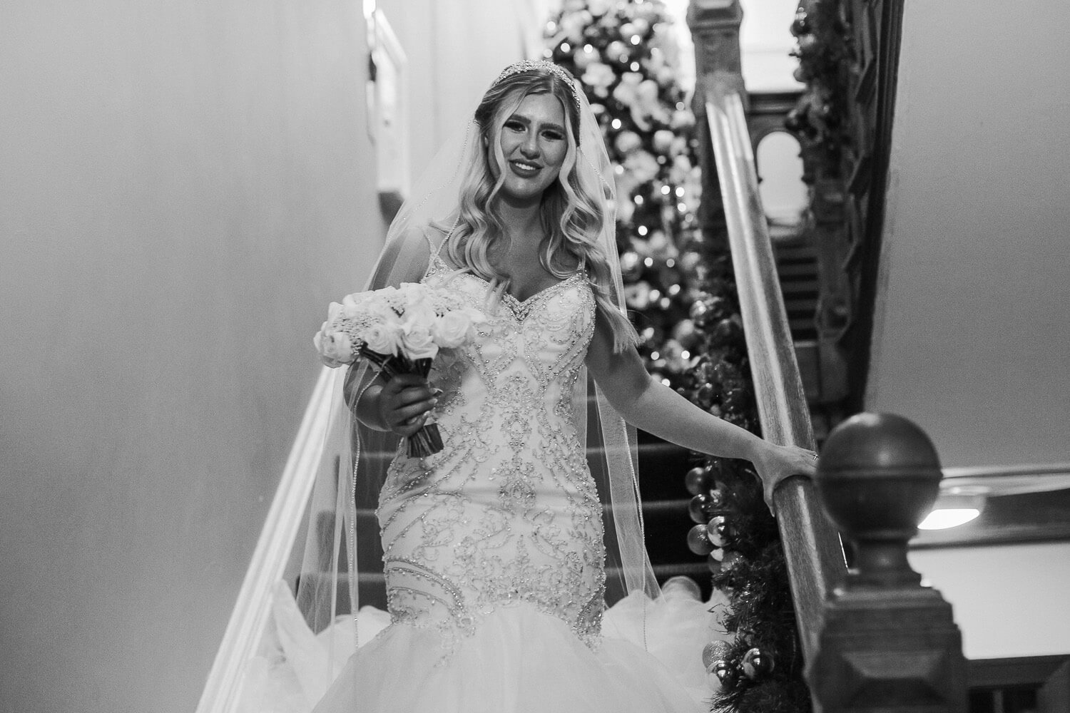 Bride coming down the stairs at WesT tower winter wedding