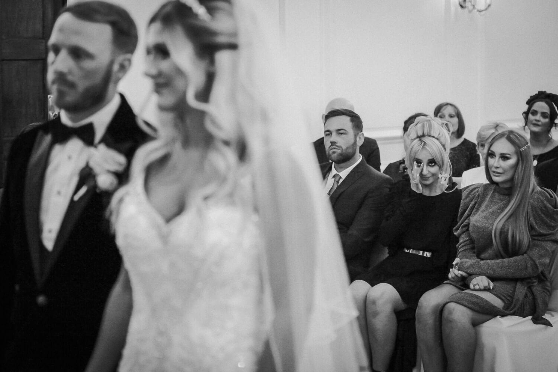 Emotional woman sipping tear watching wedding