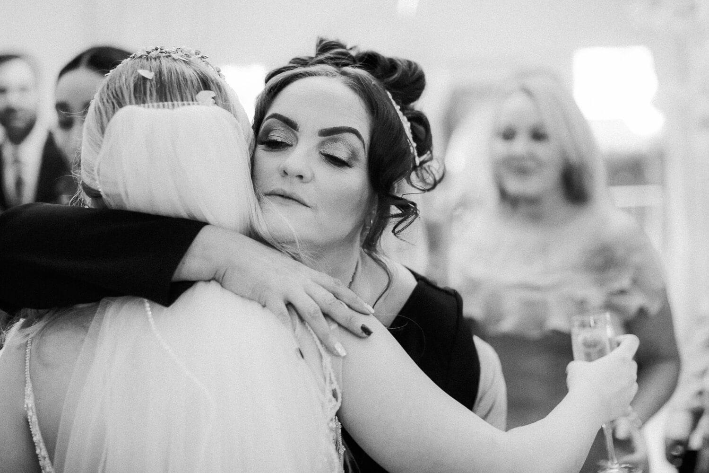 guest hugging bride