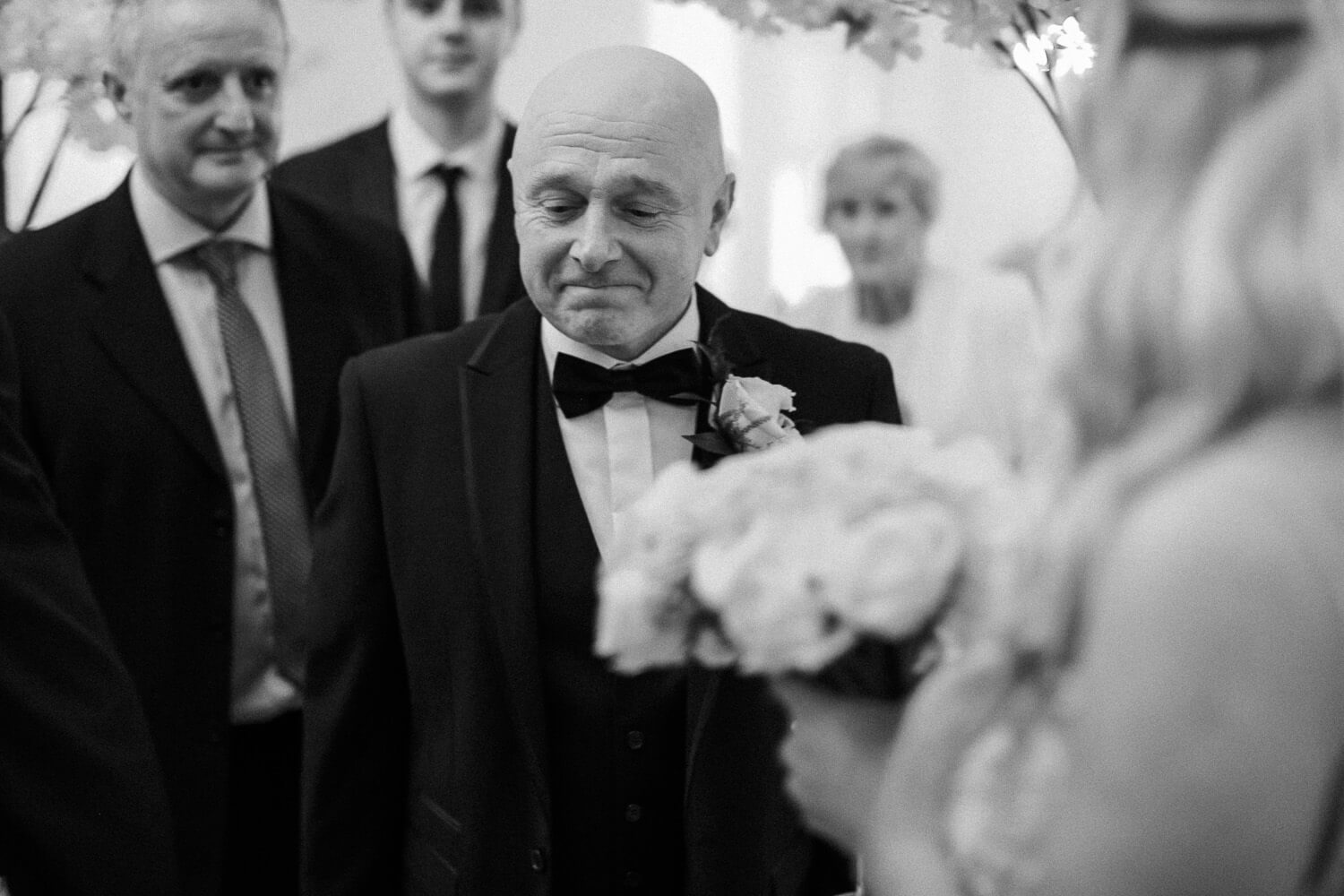 Father of groom fighting back tears