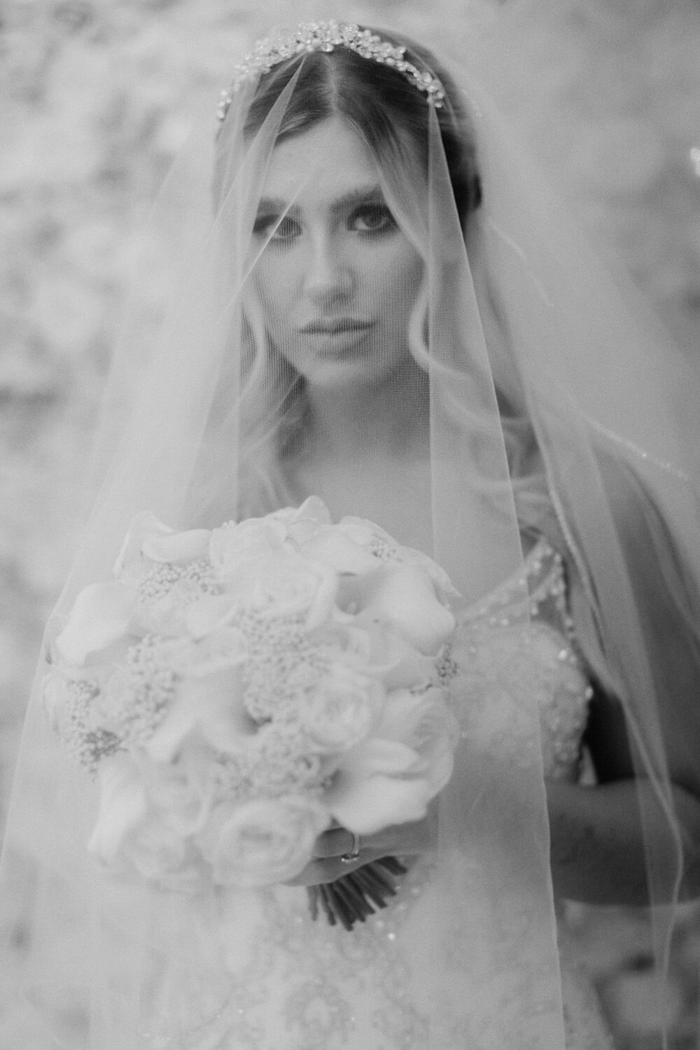 Black and white arty portrait of bride