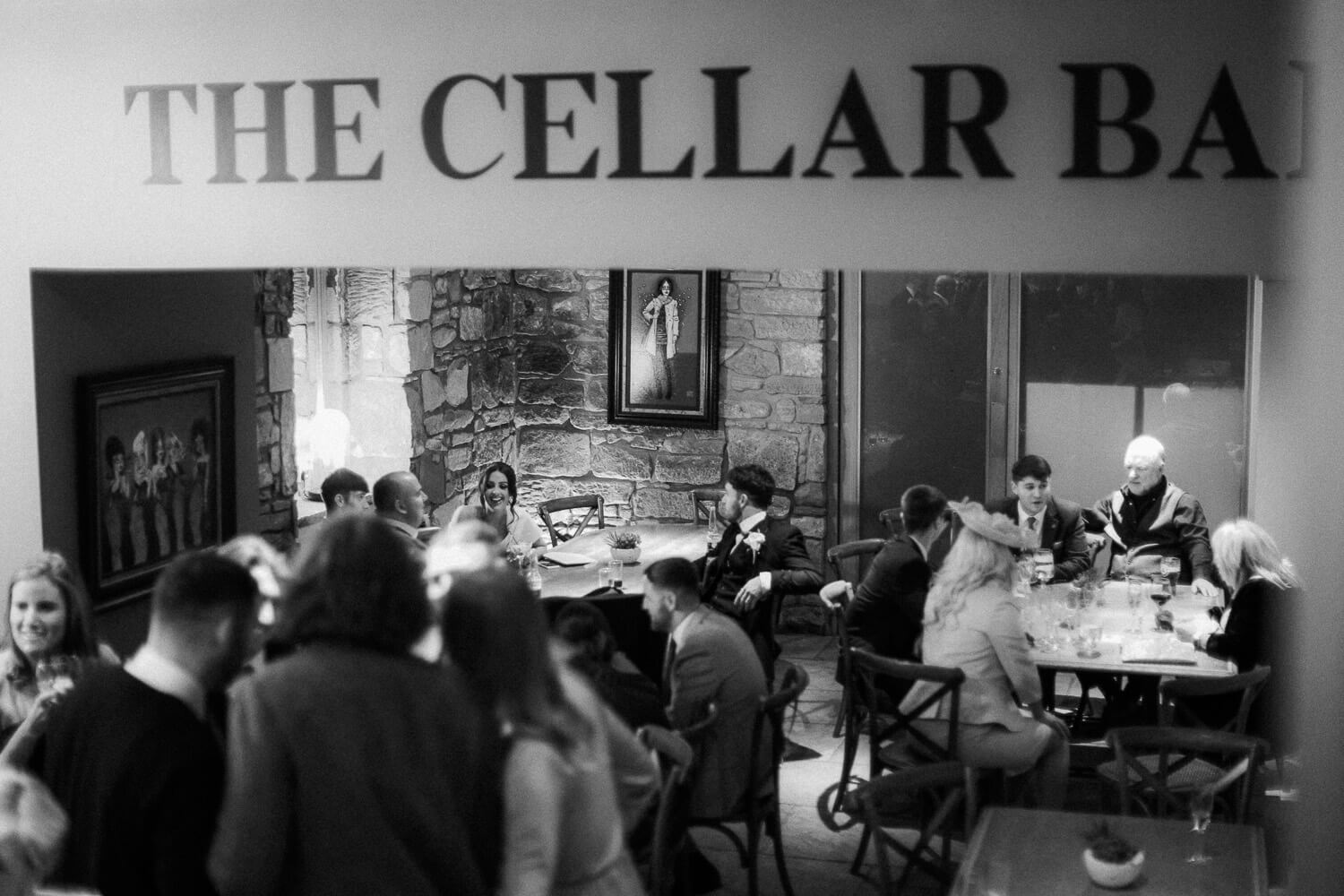 Guests talking in the cellar bar